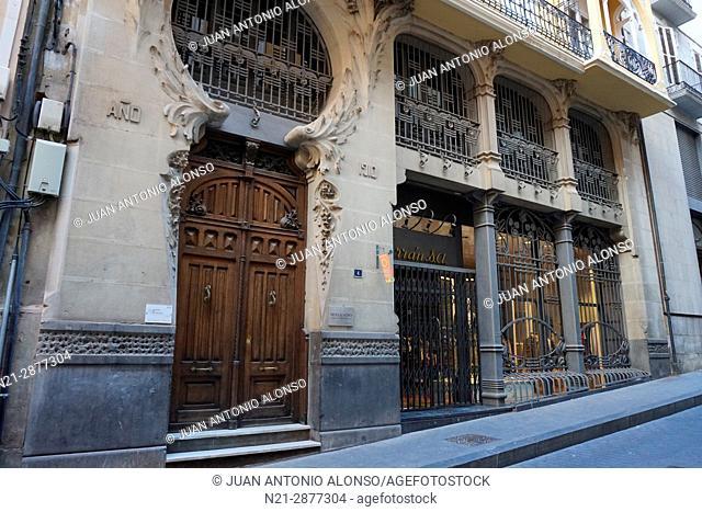 Entrance and commercial premises of Pablo Monguio's Casa Ferran. Teruel, Aragón, Spain, Europe