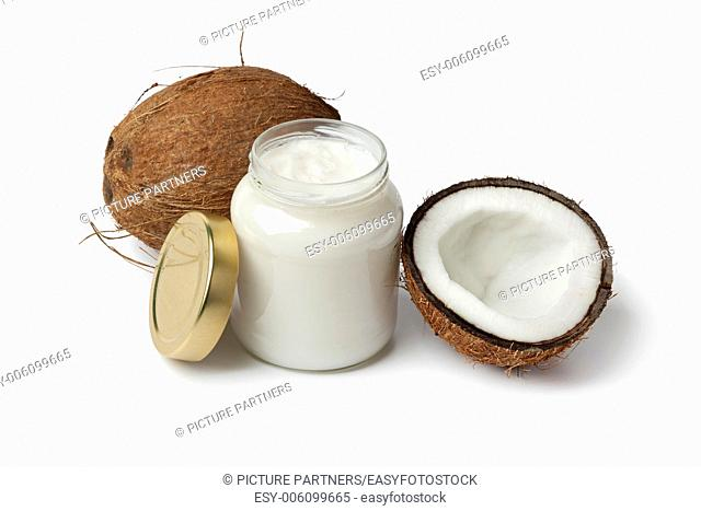 Coconut oil and fresh coconut on white background