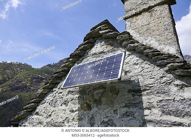 A solar panel installed on a rustic building. Maggia. Vallemaggia District. Ticino. Switzerland