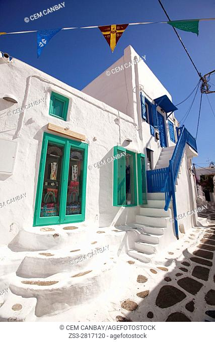 Whitewashed Cyclades house with colorful windows, doors and railings in the town center, Mykonos, Cyclades Islands, Greek Islands, Greece, Europe