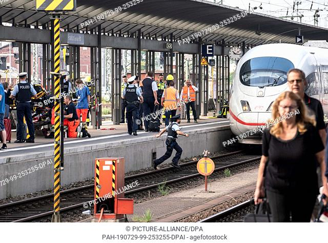 29 July 2019, Hessen, Frankfurt/Main: An ICE train is standing on track 7 of Frankfurt main station after an incident with a child occurred when the train...