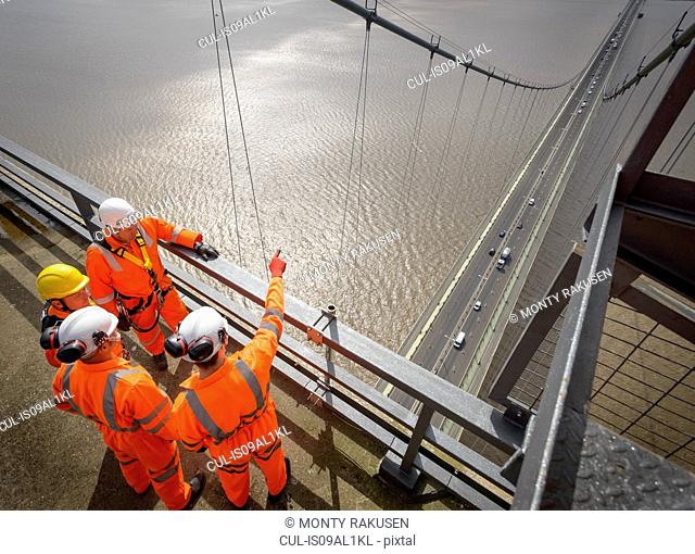 Bridge workers in meeting on top of Humber Bridge. Hessle, East Yorkshire, UK