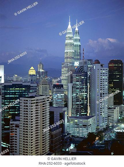 City skyline in the evening, with the twin towers of the Petronas Building, Kuala Lumpur, Malaysia, Asia