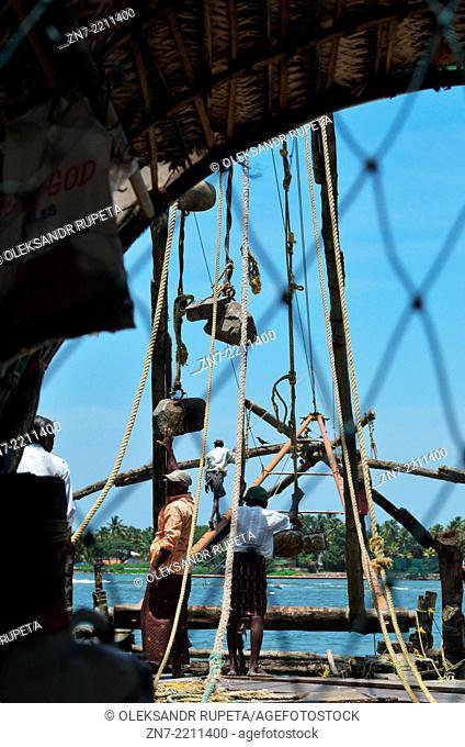 Fishermen working on Chinese Fishing Nets, Fort Kochi, Kerala, India