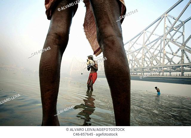 Sadhu by the Howrah Bridge. Hooghly River. Kolkata. Ganges River. India