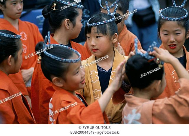 10-12 year old girls called tekomae in traditional costume during July Gion Matsuri from Uemachi neighborhood