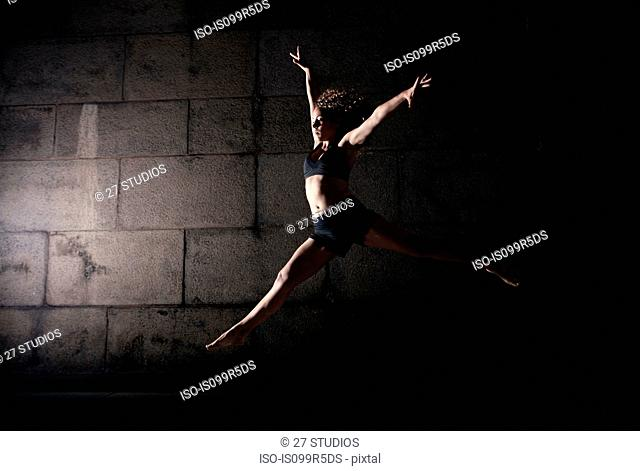 Woman jumping with legs and arms open