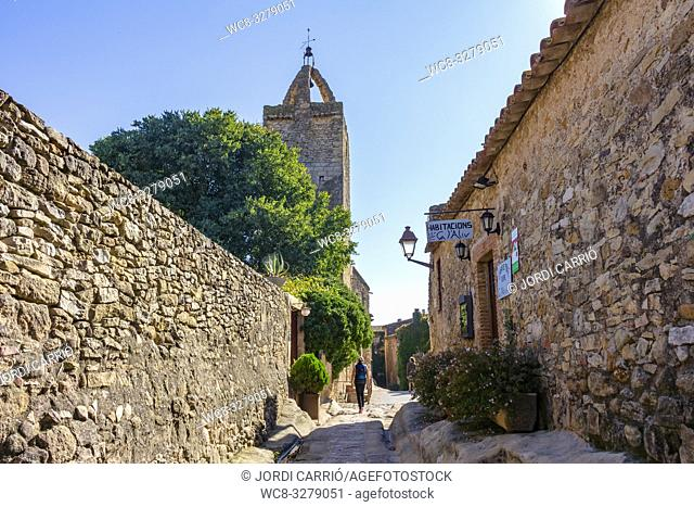 Peratallada, Catalonia, Spain - October 2016: Beautiful cobblestone street of the medieval center of Peratallada. Located in Catalonia, Spain