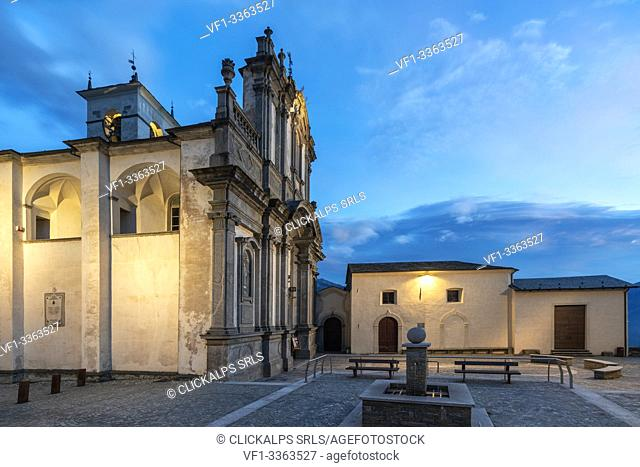 Medieval church of Caspano at dusk, Costiera dei Cech, Sondrio province, lower Valtellina, Lombardy, Italy