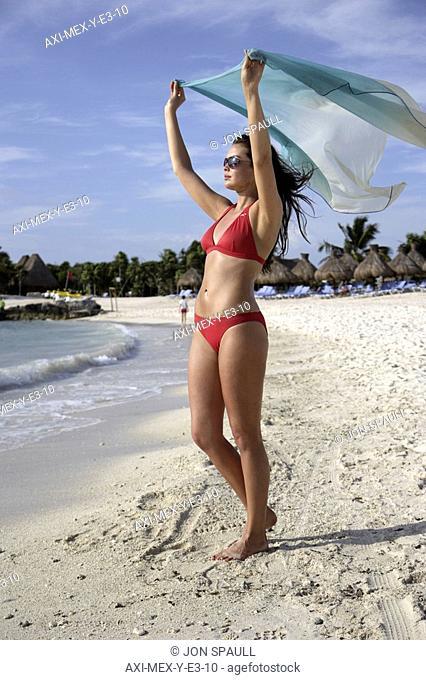 Young woman in bikini with sarong on beach at Mayan Riviera, Yucatan Peninsular,Quintana Roo State,Mexico