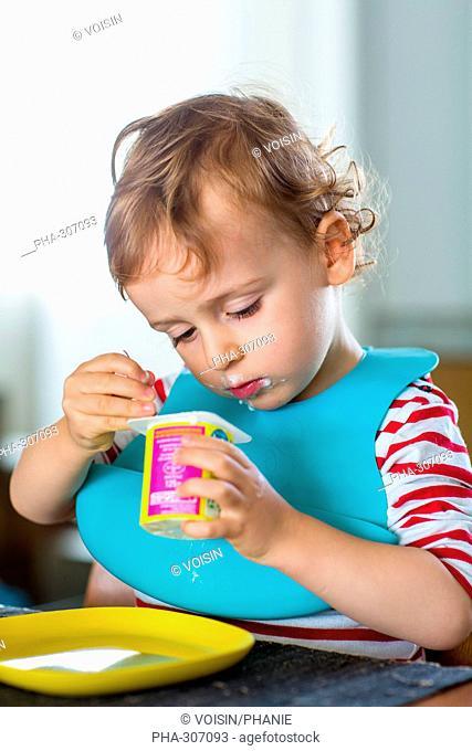 2 year-old boy eating a yoghurt