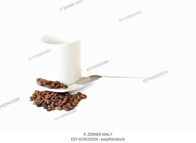 coffee mug, spoon and spilled coffee on white background