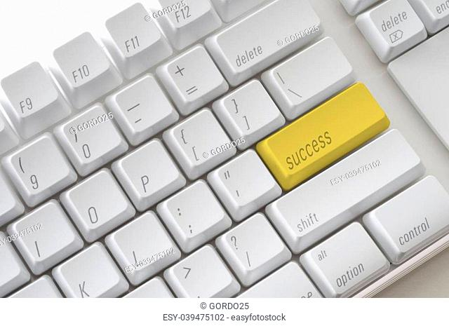 The word Success on the computer keyboard
