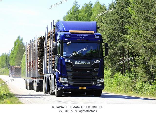 Blue Next Generation Scania R650 logging truck on test drive on rural road in spring during Scania Tour 2018 in Lohja, Finland - May 25, 2018