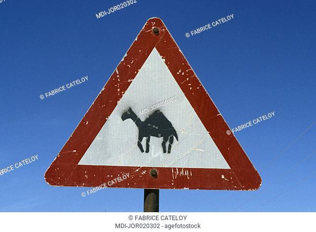 Road signpost indicating dromedary crossing