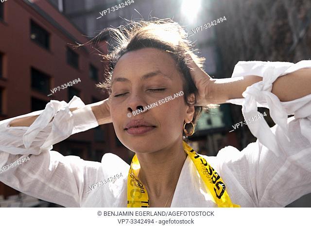 stylish woman pressing hands on head