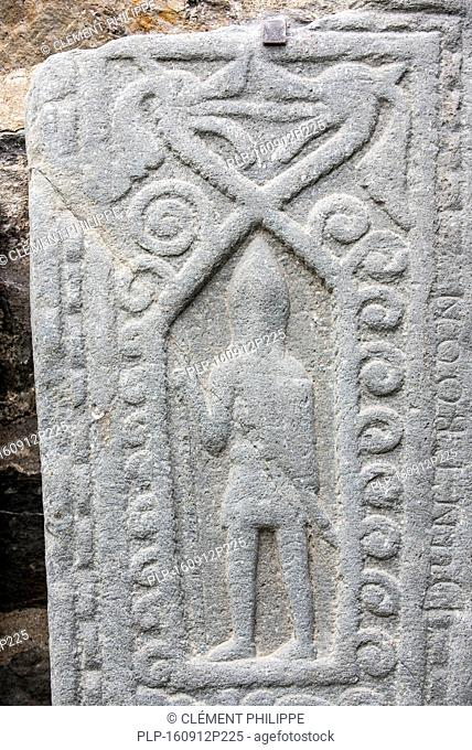 Carved medieval warrior, detail of the Kilmartin Stones, collection of 79 ancient graveslabs at Kilmartin parish church, Argyll, Scotland