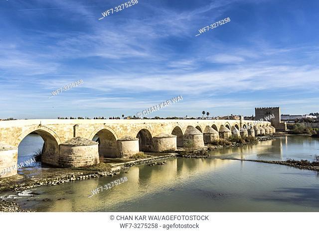 Cordoba, Spain - Dec 2018: Roman bridge of Cordoba facing the Calahorra Tower. The bridge was originally built in the early 1st century BC