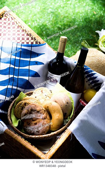 a picnic set with wine and bagels