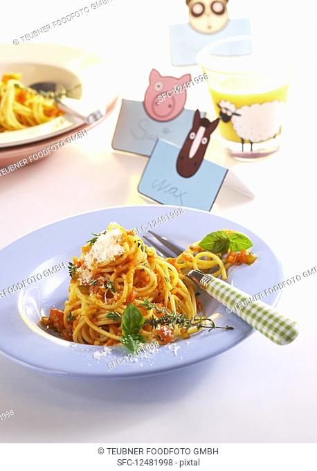 Spaghetti with vegetarian carrot bolognese sauce and herbs