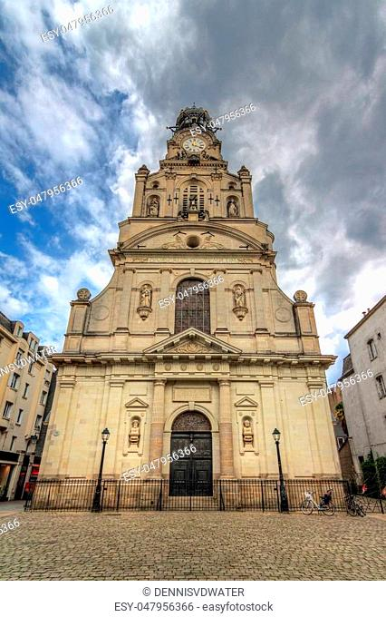 Beautiful wide angle view of the Église Sainte-Croix de Nantes in the city of Nantes, France, on a summer day with clouds