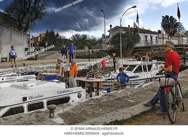 France, Herault, Villeneuve les Beziers, people attending maneuvers barges into a lock