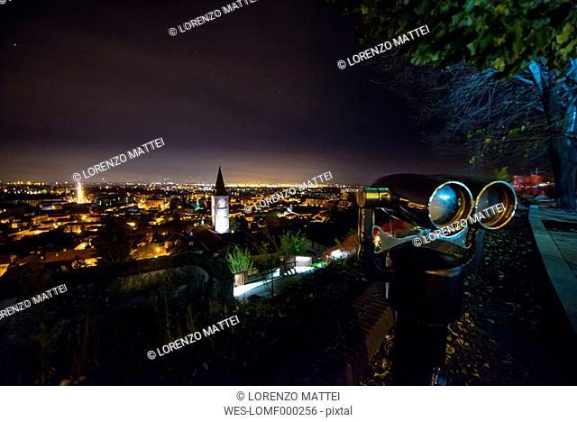 Italy, Piemonte, RIvoli, Cityscape at night, binocular
