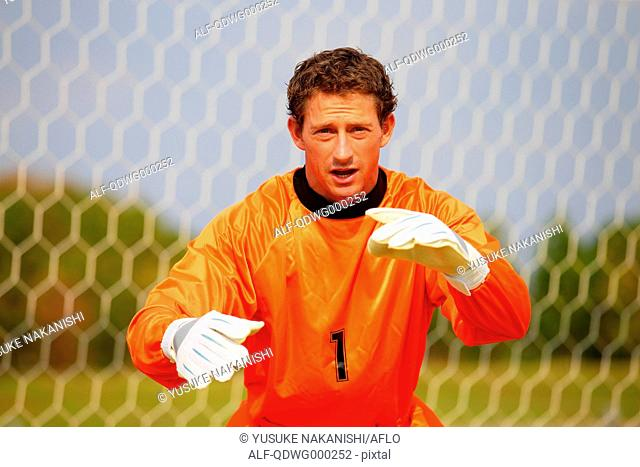 Goalkeeper in orange uniform