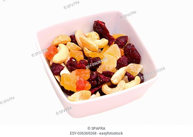 Dried fruits on square bowl on a white background