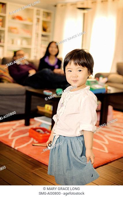 USA, Portrait of girl (2-3) smiling in living room
