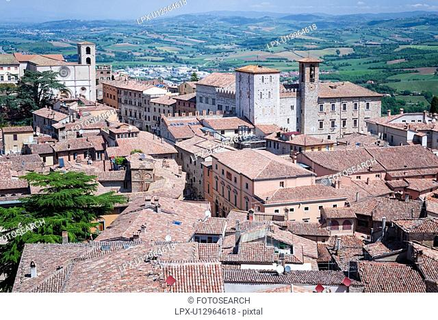 Todi: aerial view of red tiled rooftops, Palazzo del Populo, Duomo and Tiber valley beyond, on lovely spring morning, Umbria, Italy