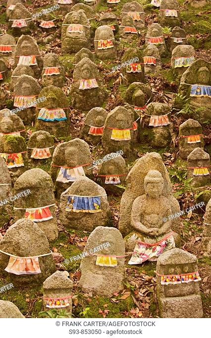 A field of many small stone figures with bibes around them that represent babies who died or were aborted near Kyomizu temple in Kyoto