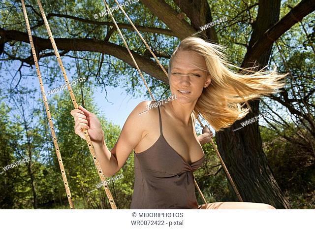 Woman smilling on swing