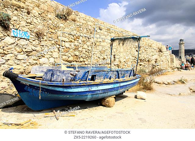 Old wrecked boat in the Venetian harbour in Rethymnon - Crete, Greece