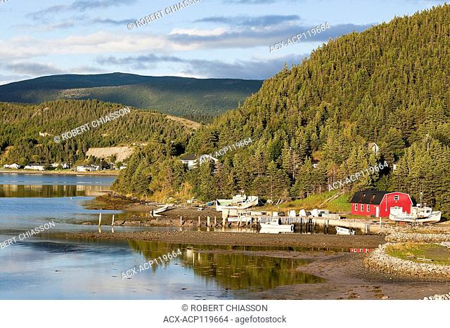 Homes spread out at the foot of mountainous terrain along the shore of Neddies Harbour, Norris Point,Gros Morne National Park, Newfoundland, Canada