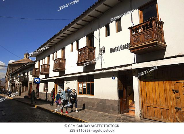 Tourists in front of the colonial buildings with balconies at the historic center, Cusco, Peru, South America