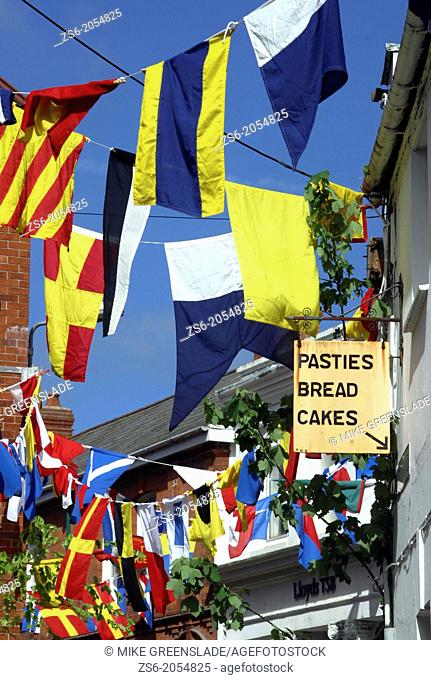 Maritime bunting decorates the streets of Padstow in Cornwall for the May Day Obby Oss celebrations, Cornwall, UK