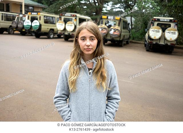 Girl in front of the visitor center of Ngorongoro Conservation Area, Tanzania, East Africa