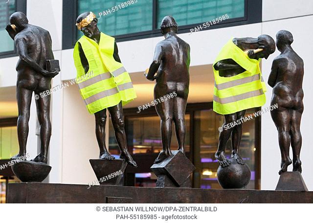 Figures of the bronze sculpture 'Die Unzeitgemaessen Zeitgenossen' (lit. 'The outmoded contemporaries') by sculptor Bernd Goebel in the pedestrian precinct are...