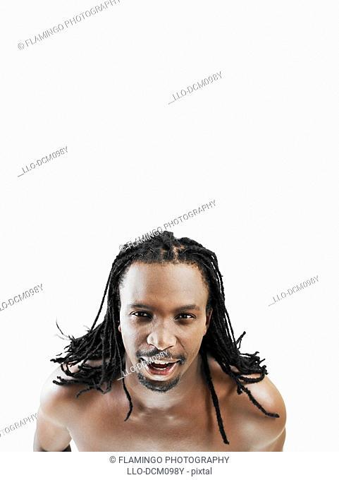 High angle studio shot of shirtless man looking up