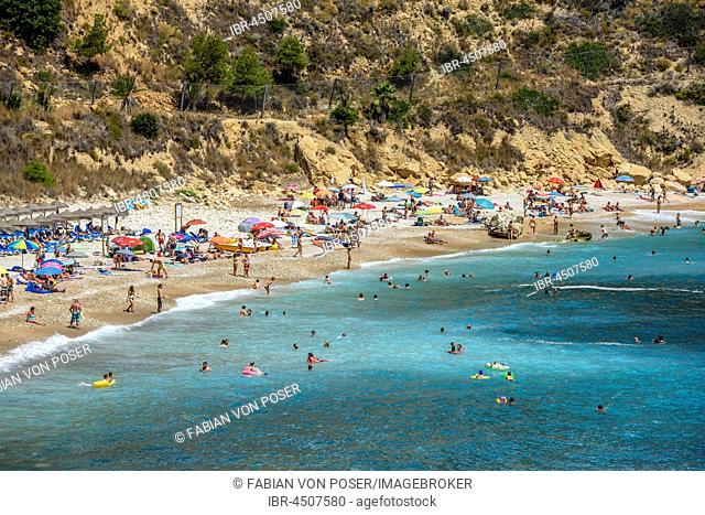 Bathers, Cala Moraig, beach Moraig near Benitachell, Costa Blanca, Spain