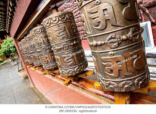 Prayer wheels at the temple in the historic streets of Shuhe Ancient Town