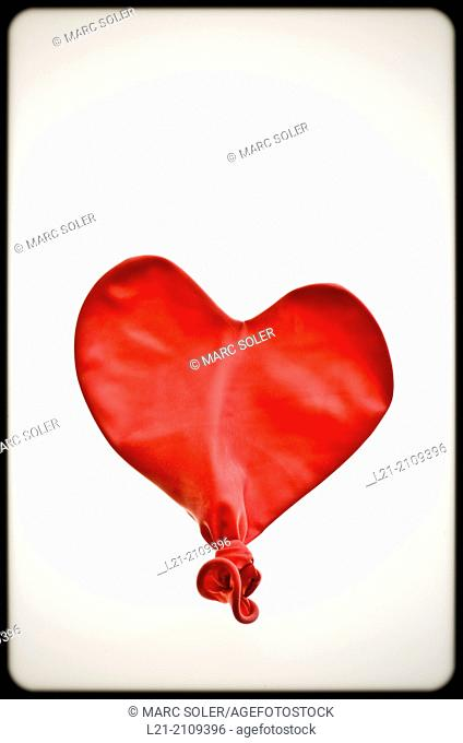 Studio Shot of deflated red balloon