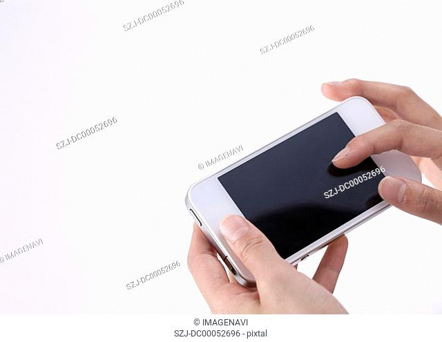 Hands holding a smartphone