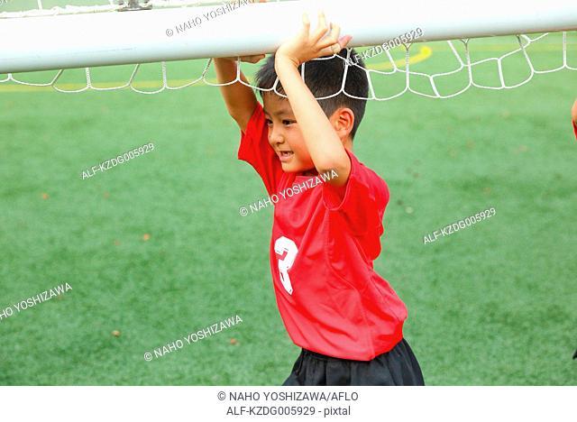 Japanese kid at soccer field