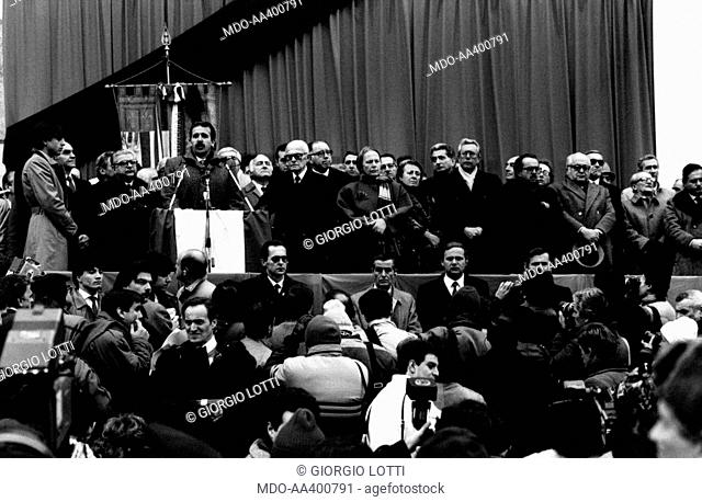 Renzo Imbeni, Sandro Pertini and other politicians in Bologna. Italian politician and Mayor of Bologna Renzo Imbeni talking to his citizens during the visit of...