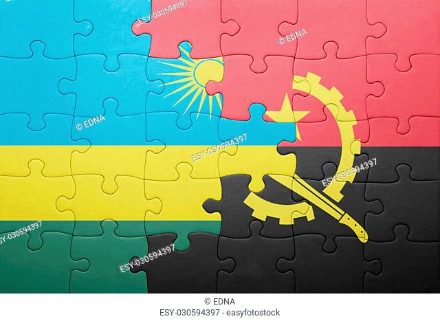 puzzle with the national flag of angola and rwanda . concept