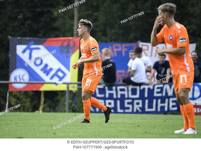 """Marco Thiede (KSC) and Tim Kircher (KSC). In the background Fanplaktate: """"""""Chaotic Karlsruhe"""""""" and """"""""KomA KSC"""""""". GES / Football / BFV Cup: TSV Hoepfingen -..."""