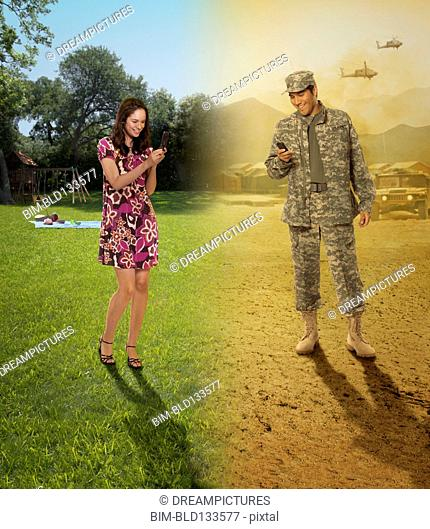 Hispanic military couple communicating by cell phone