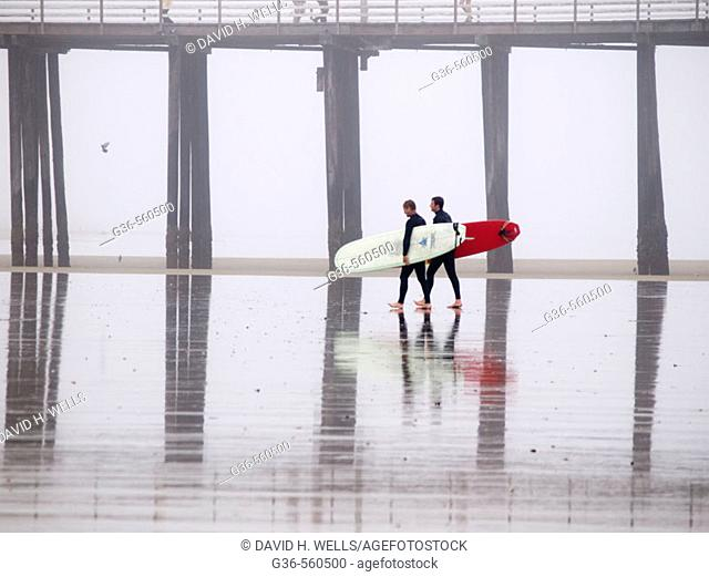 Surfers with boards in Pismo Beach, California, USA